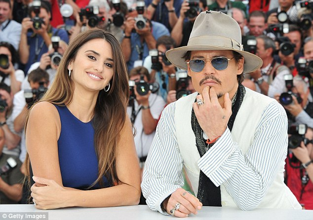 Pirates take over: Penelope Cruz and Johnny Depp wow the crowds during Cannes Film Festival photo call