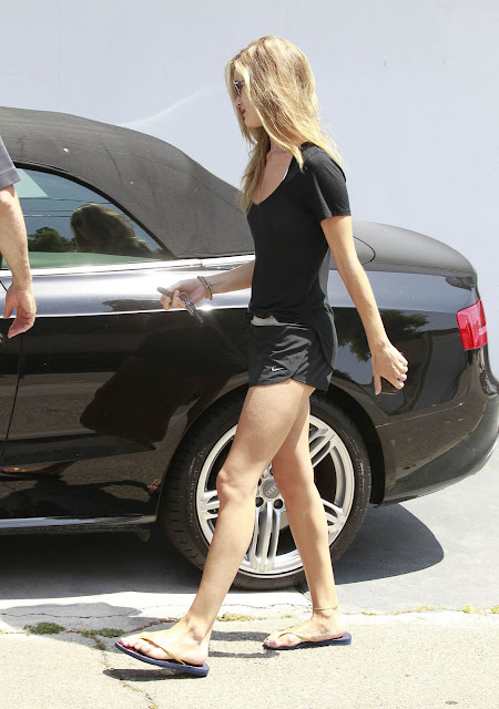 Sexy Rosie Huntington Whitely in Running Shorts nice legs