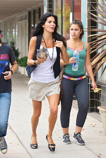 Angie Harmon  in  a hurry to get somewhere