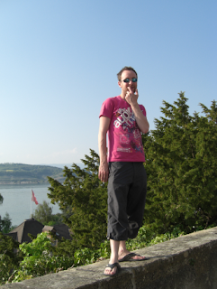 Standing on the wall viewing Lake Murten on Road trip through Swtizerland
