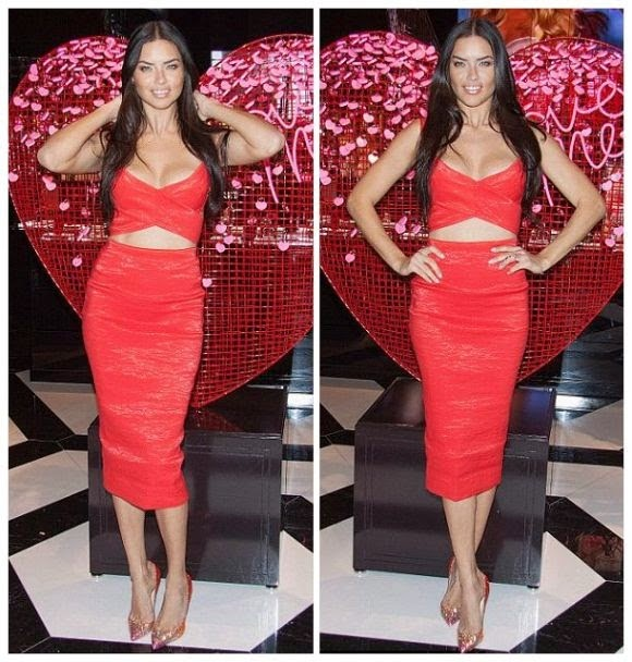 Adriana Lima wears a red dress on Valentine's Day at the Victoria's Secret shop in Las Vegas on Tuesday, February 3, 2015.