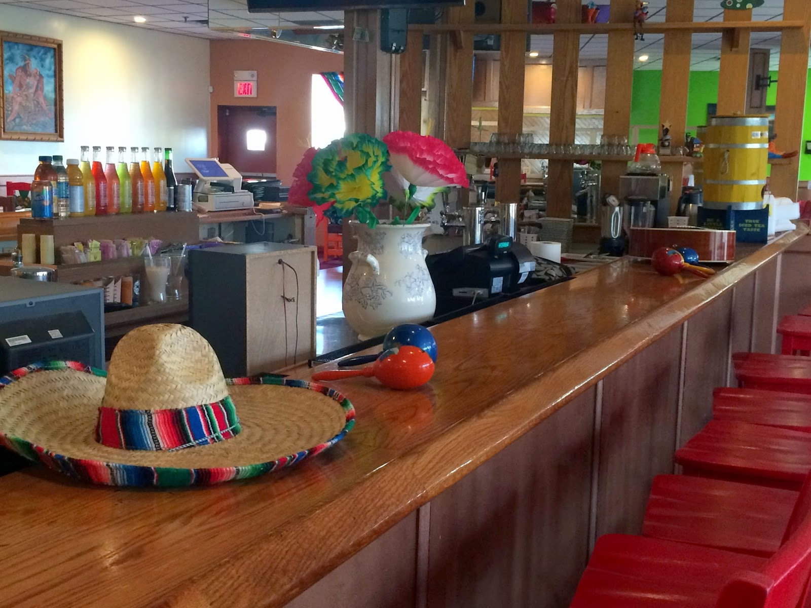 Mexican decorations for restaurants - The Cheerful D Cor Is A Refreshing Change From The Dark Bar That Was Once In This Location Mismatched Chairs In Vivid Hues Have Symbols Of Suns Maracas