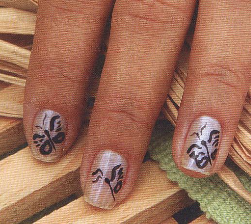 Diseños de mariposas en tus Uñas