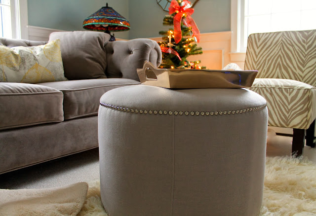 tufted couch, nailhead ottoman, zebra chairs