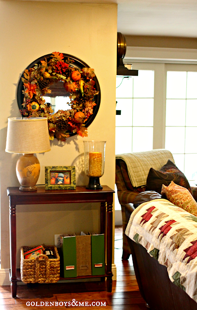 Fall wreath on mirror with Autumn quilt, part of Fall Home Tour via www.goldenboysandme.com
