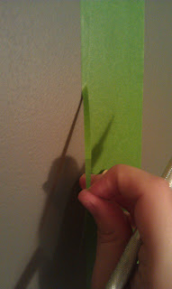 taping and using knife to cut trees for painting diy wall art mural