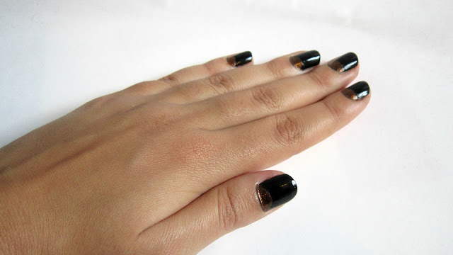 black and gold reverse manicure