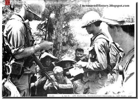 Soldiers interrogating villagers.