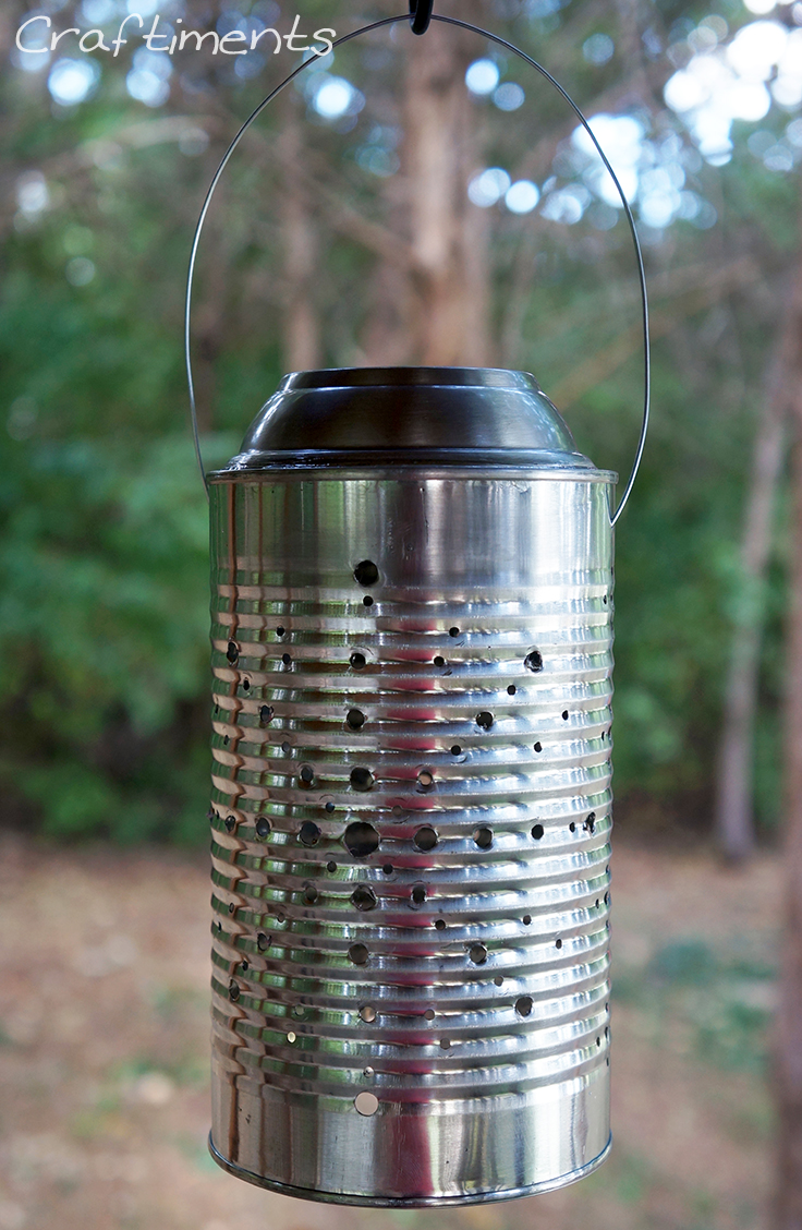 Tin can solar lantern charging in the sun.