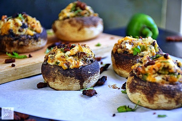 Jalapeno Popper Stuffed Mushrooms | by Life Tastes Good are loaded with everything we love about traditional jalapeno poppers, only better! All of the spicy, cheesy, bacony deliciousness of jalapeno poppers stuffed into the savory goodness of cooked mushrooms, and this twist on a classic appetizer is sure to become a new favorite! I'm hooked!