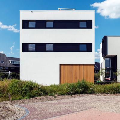 Fachada de casa moderna cubo de 10x10x10