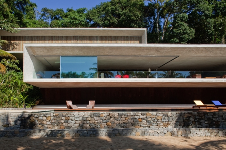 Modern beach house in Brazil by Marcio Kogan from the beach