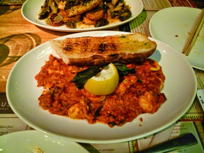 Risotto with rustic tomato sauce, seafood and basil