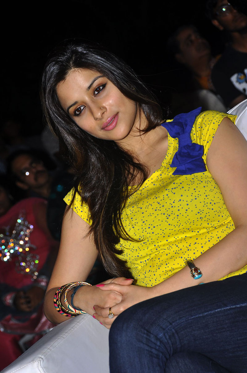 stylish majestic Madhurima banerjee in yellow top and blue jeans latest glam photos gallery