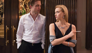 Robbert Pattinson as Eric Packer, with his billionaire wife, played by Sarah Gadon, Cosmopolis (2012), Directed by David Cronenberg