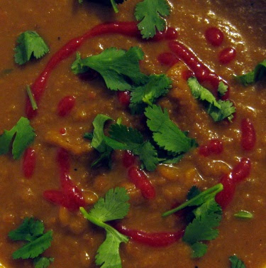 carrot soup with bean broth and cilantro sriracha garnish
