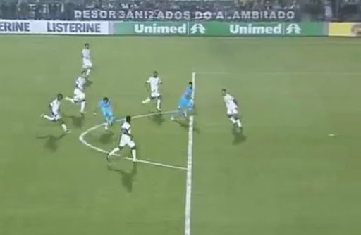 Santos forward Neymar shoots to score from outside the penalty area against Figueirense