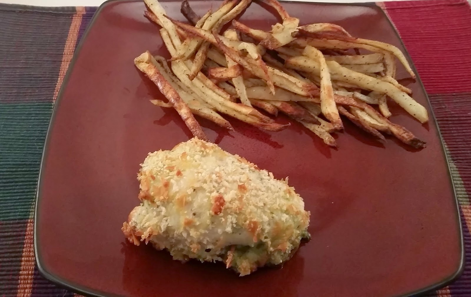 Pesto stuffed chicken thighs with homemade french fries! Married and Hungry.