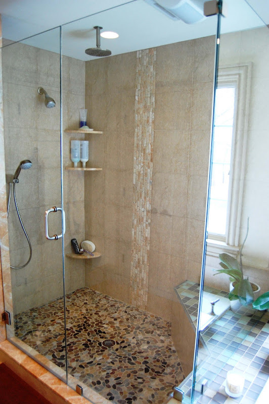 Frame less shower door tile feature give a waterfall effect when the  title=