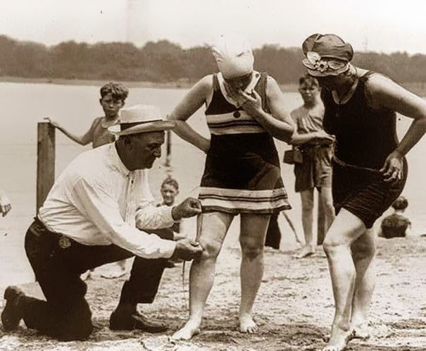 40 Must-See Photos Of The Past - Measuring bathing suits – if they were too short, women would be fined, 1920′s