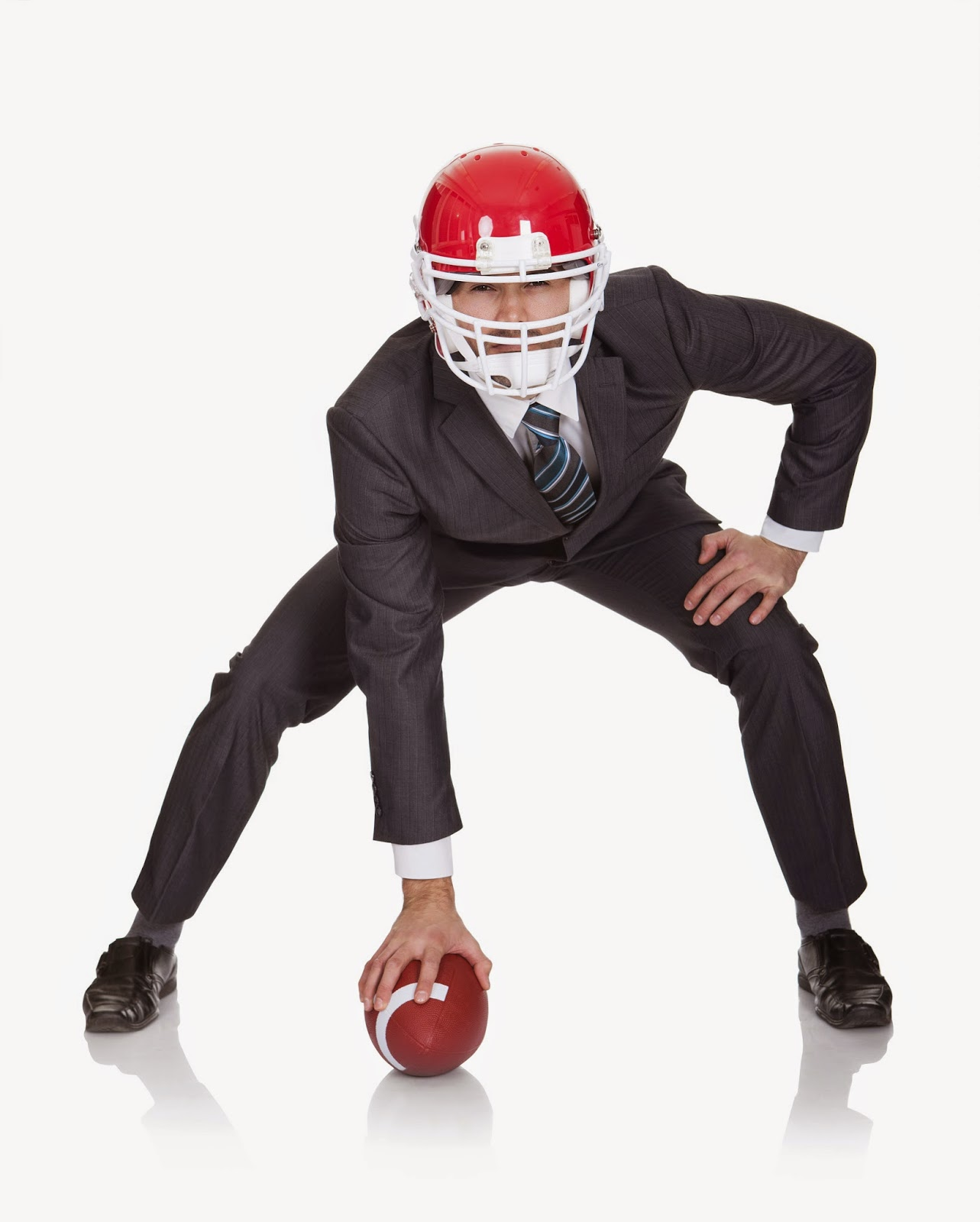 Businessman in football helmet with football