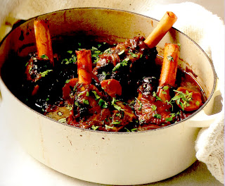 lamb shanks braised slowly in red wine and tomato passata served from the casserole dish in which they were cooked