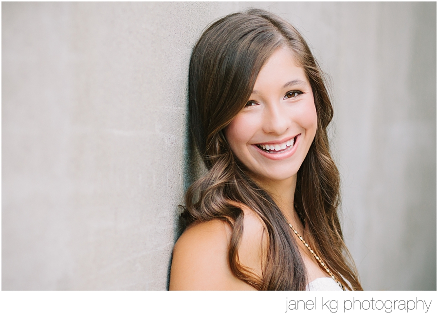 Janel KG Photography captures Liz's sparkling smile during her downtown Sacramento senior portrait session at Memorial Auditorium