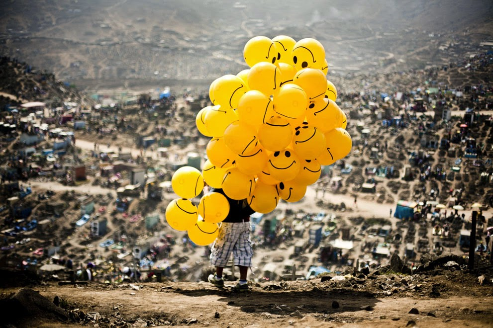 a man sells balloons in a cemetery