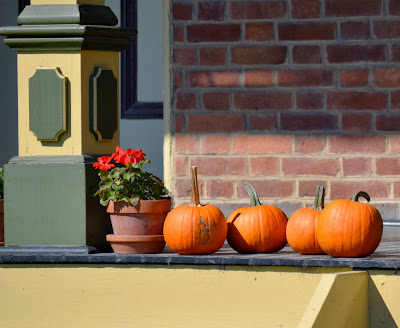 pie pumpkins in a row on the Firestone farmhouse porch