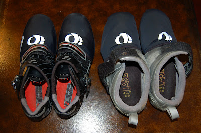 Road shoes on the left and worn-out tri-shoes on the right