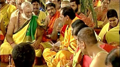 Telangana Chief Minister K Chandrasekhar Rao performed the fist day of 'Ayutha Chandi Maha Yagam', at his farm house in Medak district braving criticism from the opposition.  The Governor of Telangana and Andhra Pradesh E S L Narasimhan also took part in the reportedly Rs 7 crore yagna, which is being performed by for people's welfare.