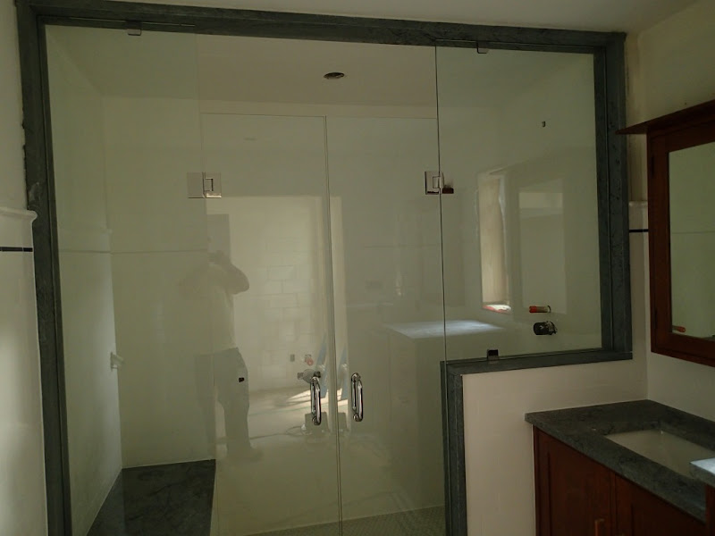 The shower. Soapstone jamb. Glass enclosure with title=