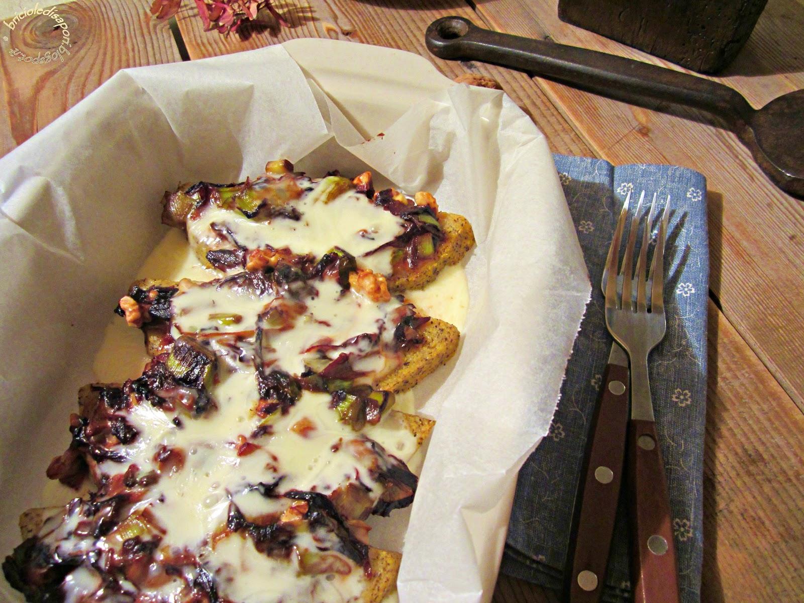 fette di polenta taragna al forno con verdure, formaggio fuso, noci e zafferano
