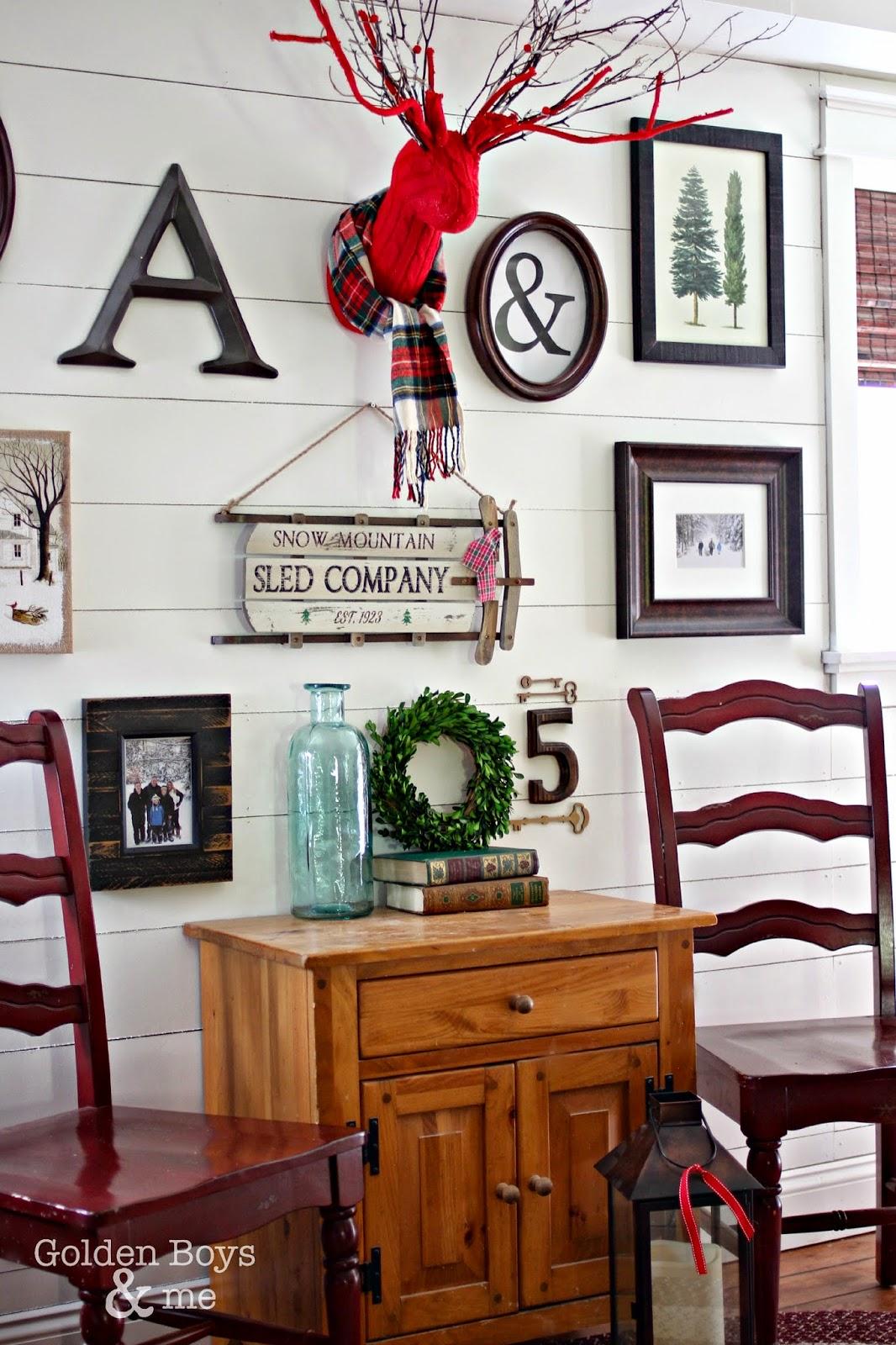 Winter Christmas themed gallery wall on plank wall-www.goldenboysandme.com