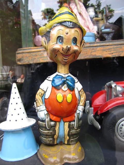 Vintage Pinocchio toy in Nyhavn, Copenhagen, Denmark.