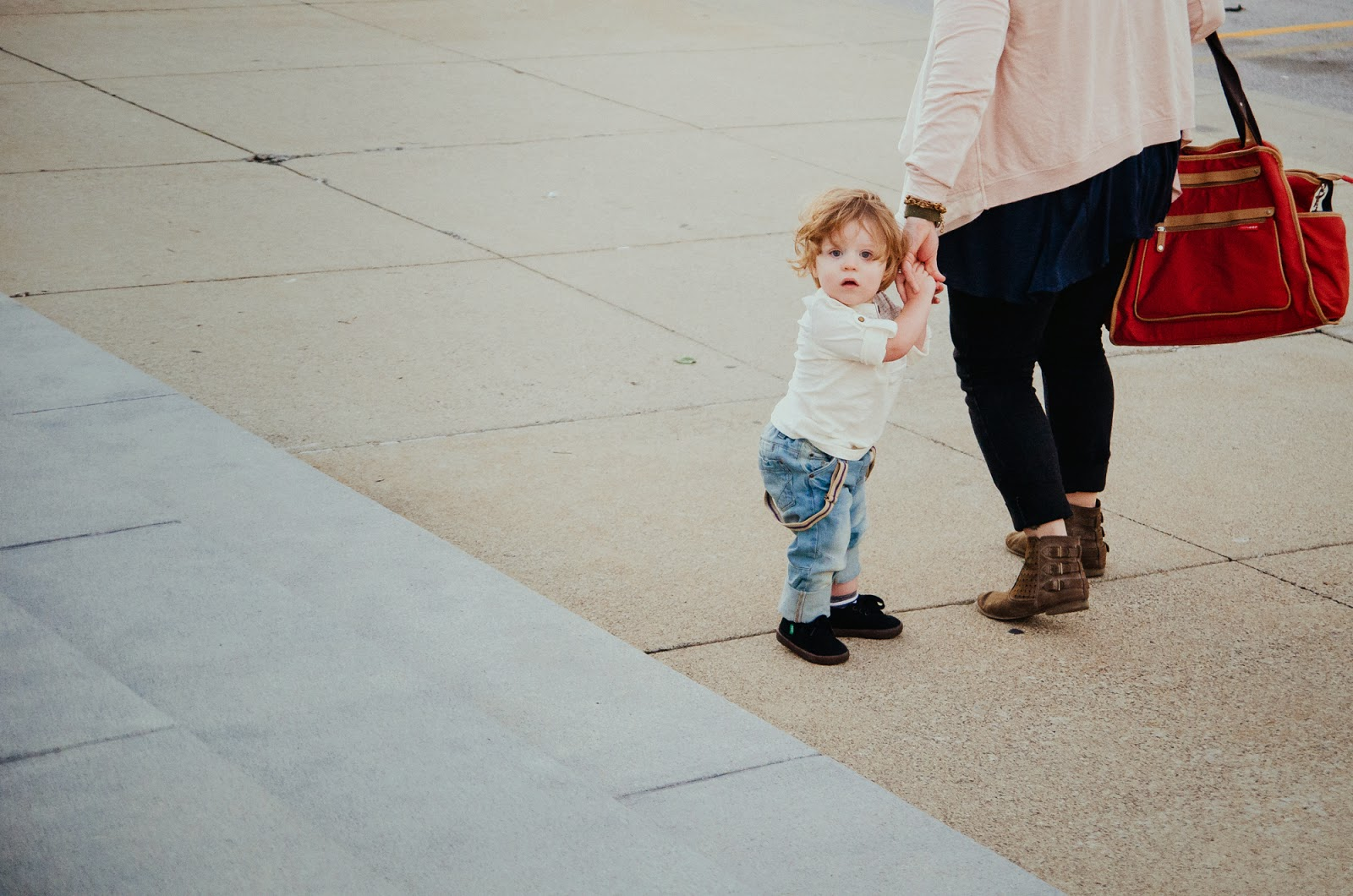 baby and mom walking through downtown indianapolis, photographs
