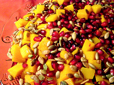 Plate of Roasted Butternut Squash with Pomegranate abd Pumpkin Seeds