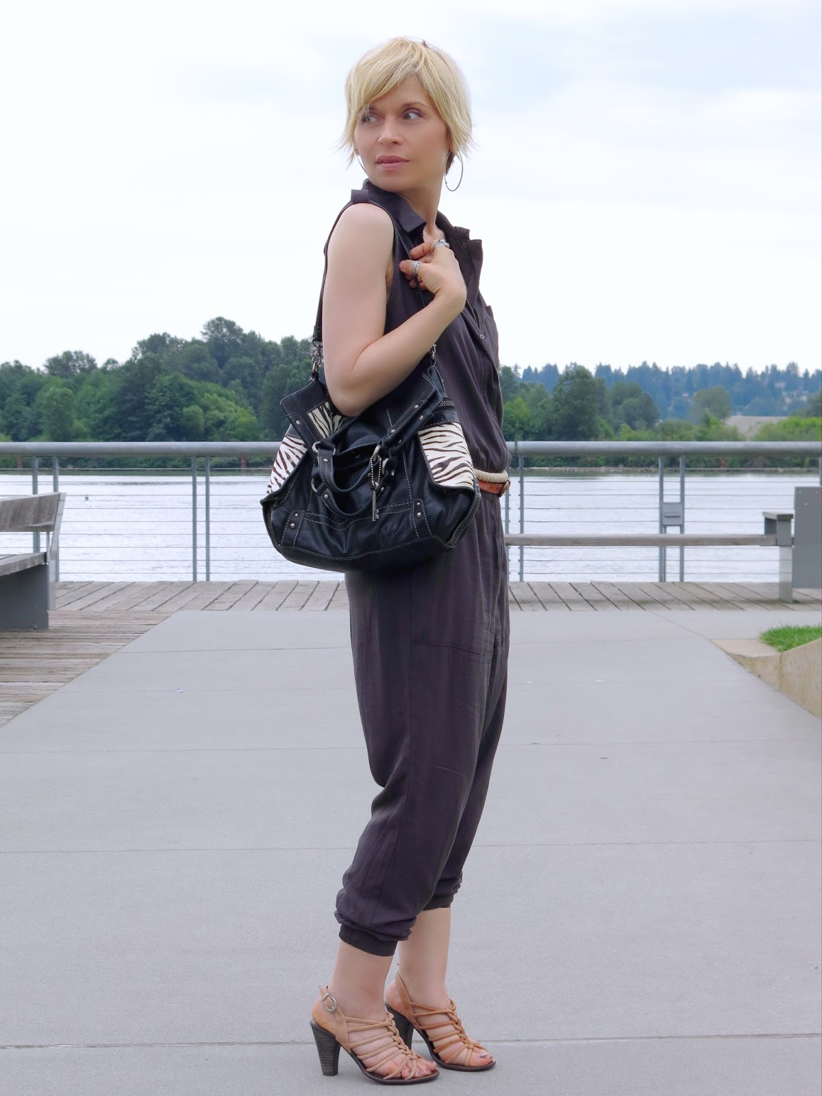 styling a utility-style jumpsuit with a double-wrap rope belt and strappy nude sandals