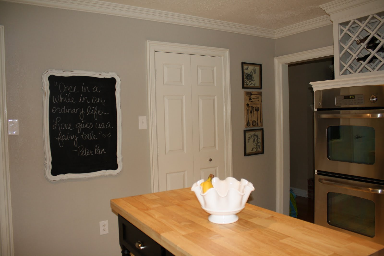The paint is a light gray. Benjamin Moore Revere Pewter