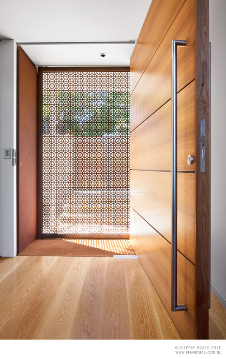 Wooden entrance door of the River House by MCK Architects