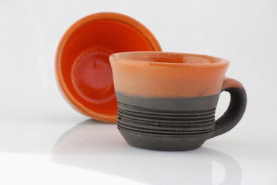 https://www.etsy.com/listing/109437105/handmade-coffee-mugs-in-orange-and-black?ref=favs_view_3