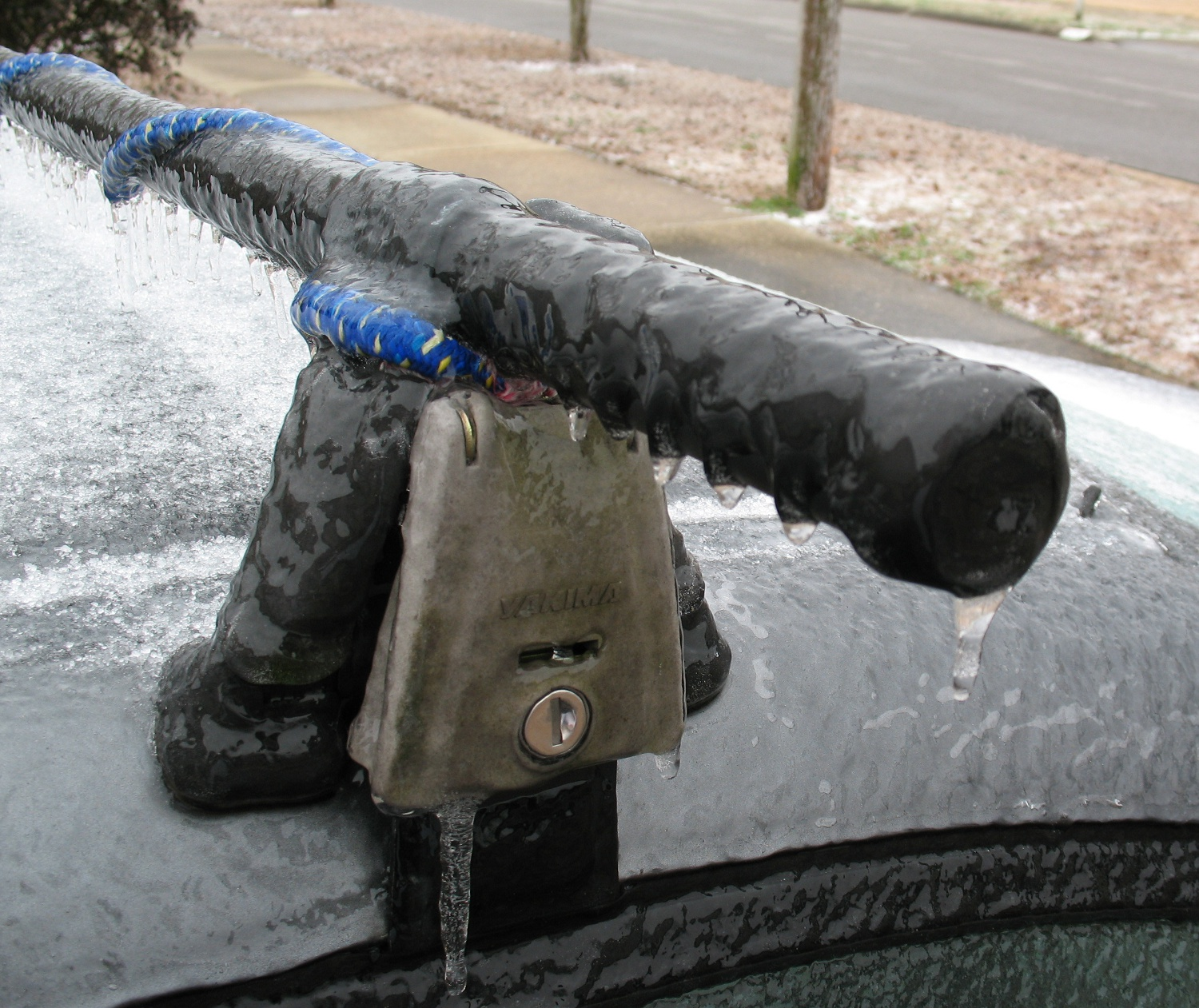 car roof rack encased in ice