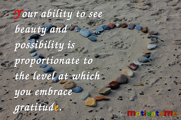 """Your ability to see beauty and possibility is proportionate to the level at which you embrace gratitude."" Picture of a heart made of stones on a beach. m.otivate.me"