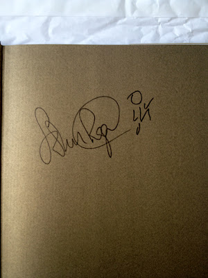 John Regis signed book