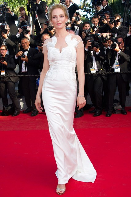 Uma Thurman in a white satin Marchesa gown and Jimmy Choo heels at Cannes 2014