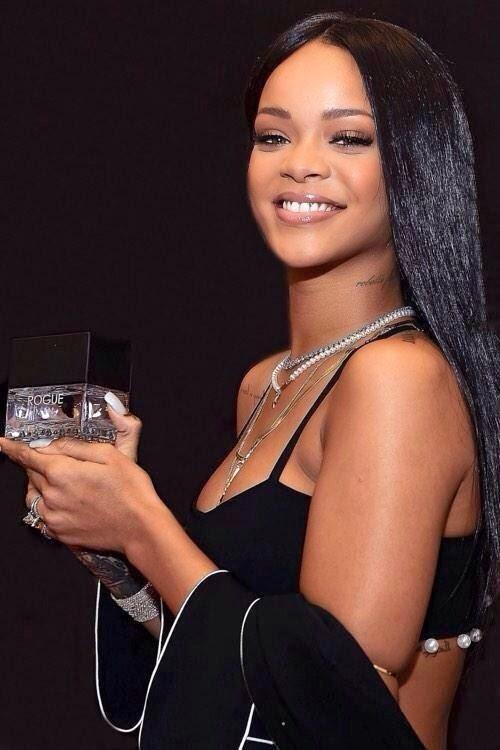 Rihanna launches new men's fragrance in a black Adam Selman attire in Atlanta