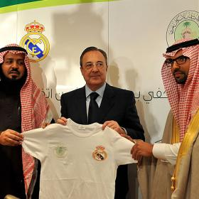 Perez holds a Real Madrid jersey during the presentation of the Riyadh academy