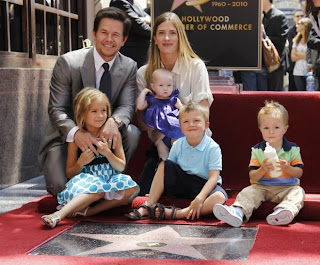 Mark Wahlberg photographed at his Hollywood star with his wife and family