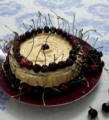 flour less cake with dark chocolate, fresh cherries, balsamic poached strawberries and loads of love...butter cream icing with hint of coffee | gluten free cake...