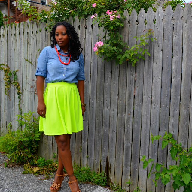 denim shirt worn with neon skirt